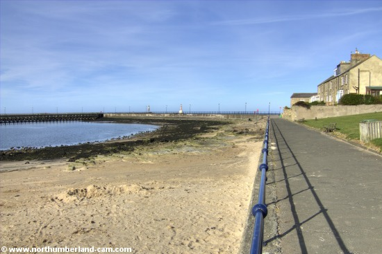 View of the small beach in Amble beside the harbour.