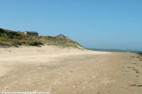Holiday homes on the dunes at the north end of Embleton Bay.