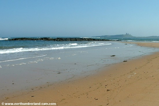View south along the beach to Dunstanburgh Castle.