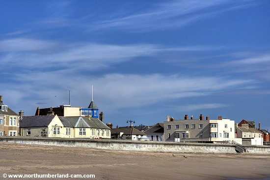 View of the sea wall, promenade and the Cafe Riviera - a famous Newbiggin landmark.