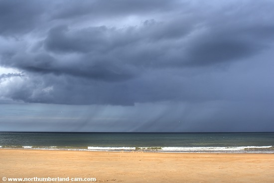 A summer rain shower approaching from the sea.